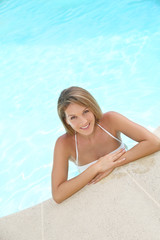 Upper view of beautiful blond woman in swimming pool