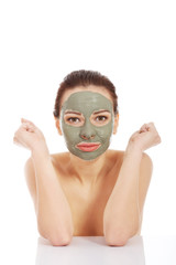 Woman in green face mask sitting at the desk