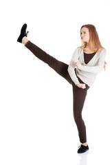 Full length woman kicking