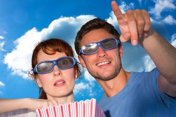 Composite image of couple enjoying a movie night