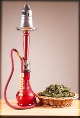 Red hookah on a wooden table
