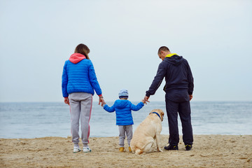 family walking near the sea