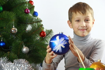 boy painted with Christmas balls