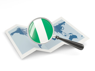 Magnified flag of nigeria with map