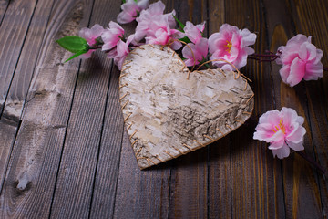 Heart on wooden background.