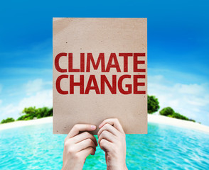 Climate Change card with a beach on background