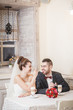 the bride and groom drink latte