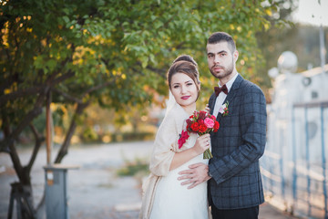 bride and groom in the autumn park
