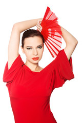 Front view of a latino dancer wearing red dress