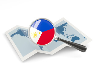 Magnified flag of philippines with map