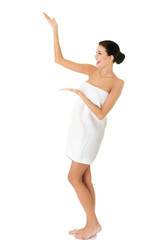 Full length woman wrapped in towel showing space
