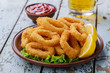 Leinwandbild Motiv fried squid rings breaded with lemon