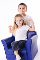isolated studio portrait two young children brother and sister