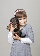 Smiling girl with puppy2