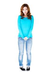 Full length shy woman standing