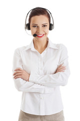 Smiling call center woman with folded arms
