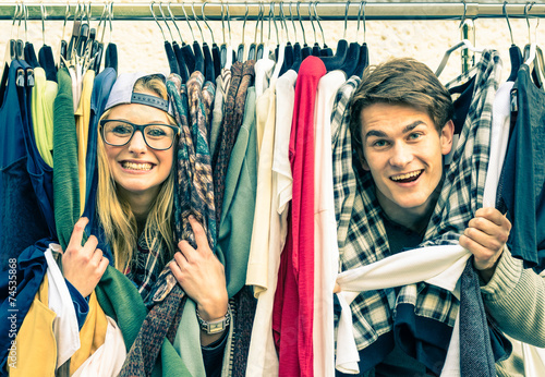 Young hipster couple in love at shopping market - 74535868