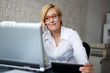 Blonde businesswoman in glasses call by smartphone