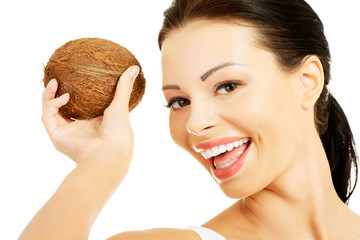 Portrait of smiling woman with a coconut