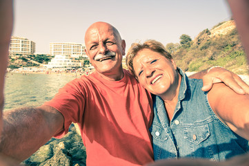 Senior happy couple taking selfie at Blue Grotto resort in Malta