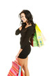 Side view woman with a lot of shopping bags