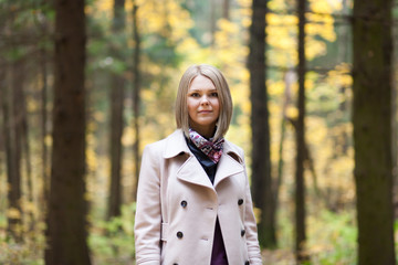 Pretty young woman in autumn forest