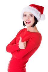 Woman in santa clothes gesturing thumbs up