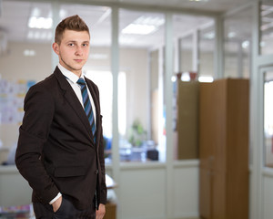 Young male businessman in the office