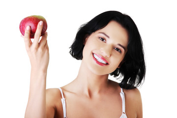 Smiling beauty holding red apple