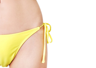 Close up on female body in swimsuit