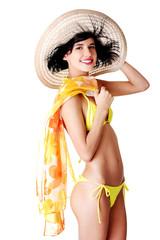 Side view woman wearing swimwear and summer hat