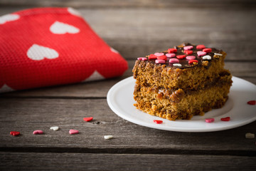 cake with hearts on wooden background