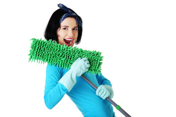Portrait of happy woman with a mop