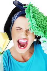Portrait of screaming woman with a mop and sponge