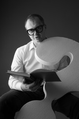 Portrait of a mature man reading book; education concept