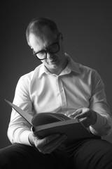Portrait of a man reading aloud, monochrome