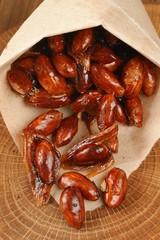 Almond in caramel in paper pack
