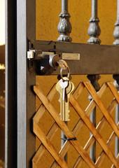 Open iron gate, lock with keys