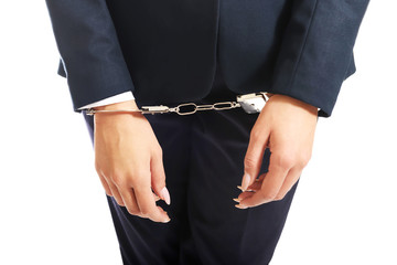 Close up on businesswoman with handcuffs