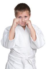 Serious boy in kimono against the white