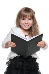 Laughing little girl with a notebook