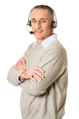 Side view of call center man with folded arms