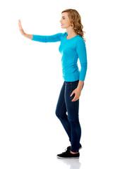 Side view woman touching imaginary screen