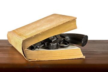 book with handgun