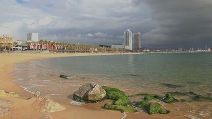 Green rocks on the Barceloneta Beach