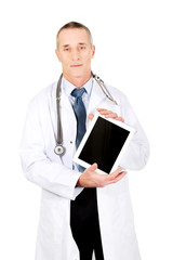 Mature male doctor showing his tablet