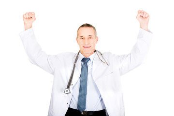 Portrait of cheerful male doctor with raised arms