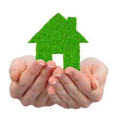 Hands holding green house symbol