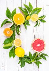 Citrus fruits on white background. Letter C mixed fruits.