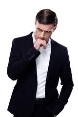 Handsome pensive businessman standing over white background
